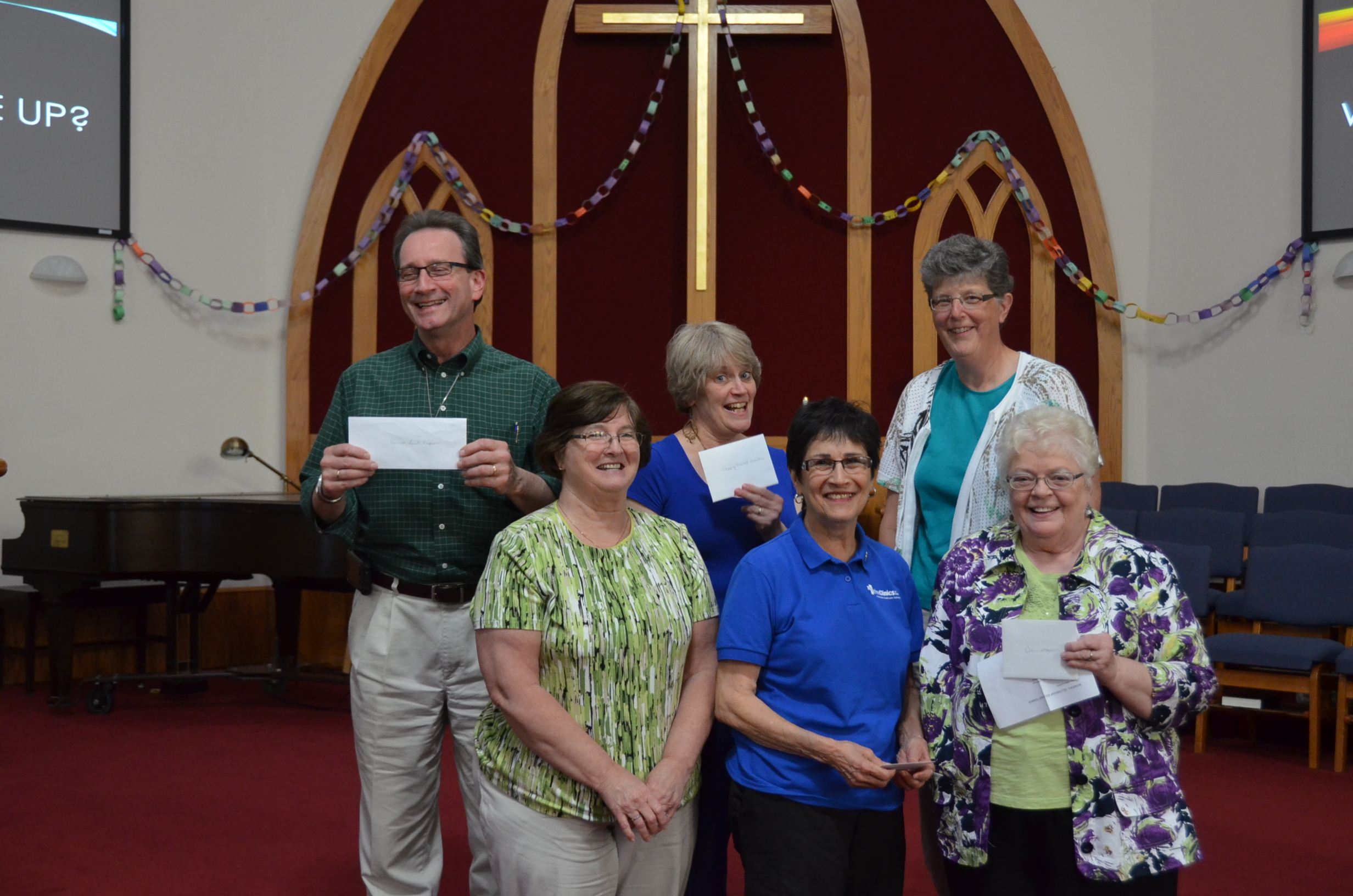 Some grateful recipients of grant money raised by the Women's Fellowship!